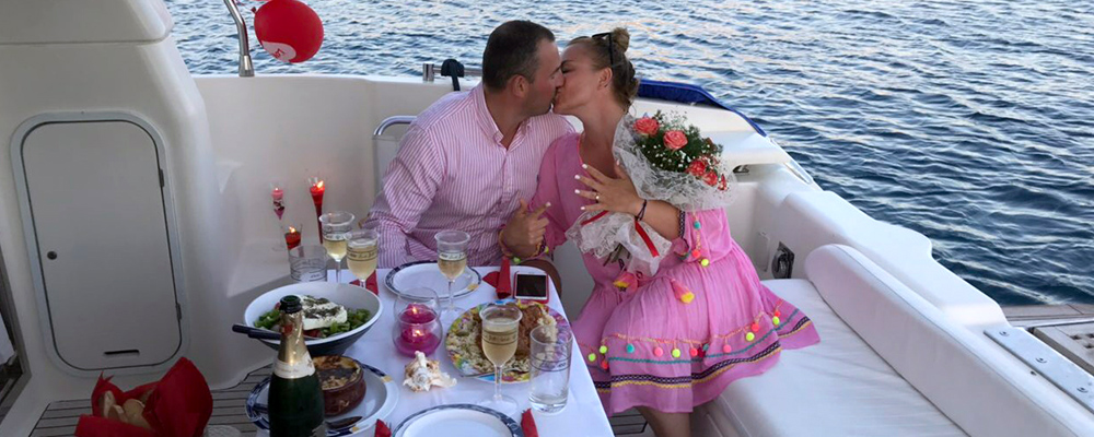 Wedding proposal on boat cruise with sea sun yacht charter